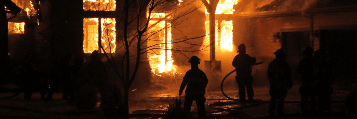 Firefighters putting out a burning building that may have been arson